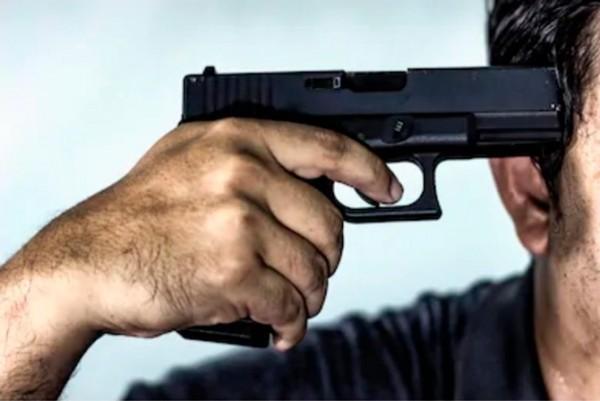 Azərbaycanda DƏHŞƏT HADİSƏ: Polis öz silahı ilə İNTİHAR ETDİ